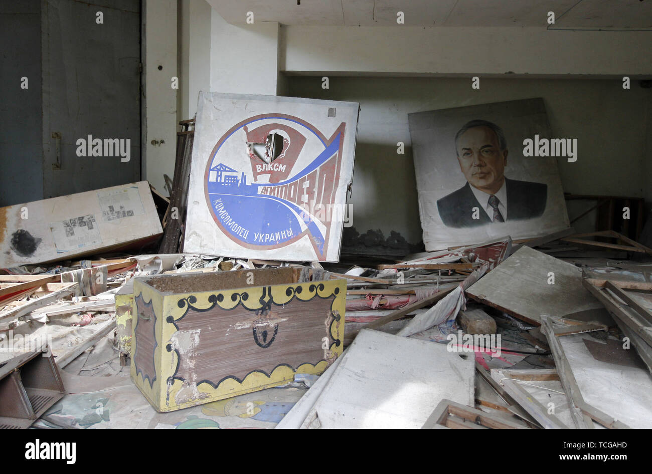 June 7, 2019 - Kiev, Ukraine - Soviet posters are visible in a building in abandoned city of Pripyat, mentioned in the HBO's television miniseries 'Chernobyl', with a view on Chernobyl nuclear plantm during a tour in Chernobyl, Ukraine, on 7 June 2019. The success of a U.S. HBO's television miniseries 'Chernobyl' has renewed interest around the world on Ukraine's 1986 nuclear disaster. Tourism to Chernobyl has spiked 40% following the debut of the HBO series in May, tour agencies reported . Last April Ukrainians marked the 33rd anniversary of the Chernobyl disaster in then-Soviet Ukraine, caus - Stock Image