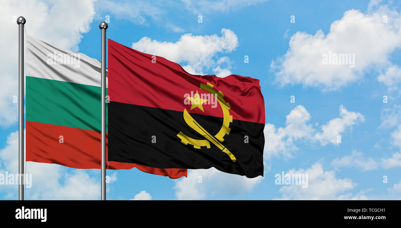 Bulgaria and Angola flag waving in the wind against white cloudy blue sky together. Diplomacy concept, international relations. - Stock Image