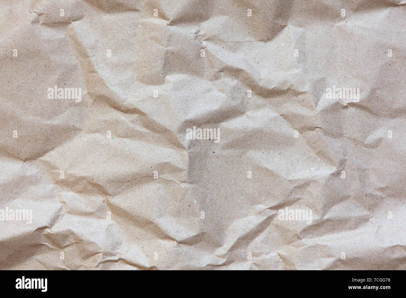 Abstract texture. Crumpled craft paper background. Copy space for text. Horizontal. DIY, handicraft, back to school, ecology, plastic free concept - Stock Image