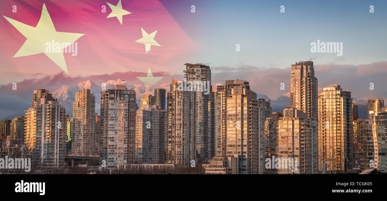 A Chinese flag superimposed over a sunset view of downtown Vancouver, BC, with a view of the snowy mountains in the background. - Stock Image