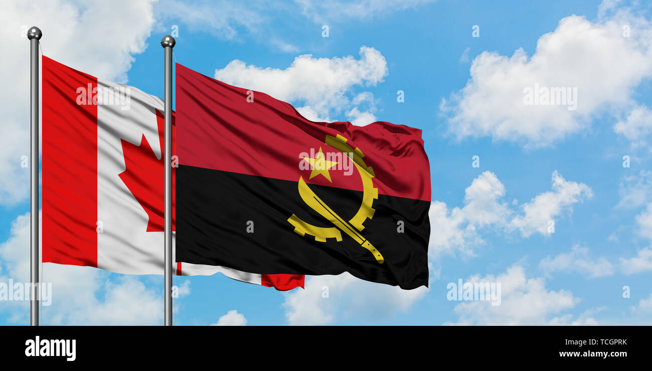Canada and Angola flag waving in the wind against white cloudy blue sky together. Diplomacy concept, international relations. Stock Photo