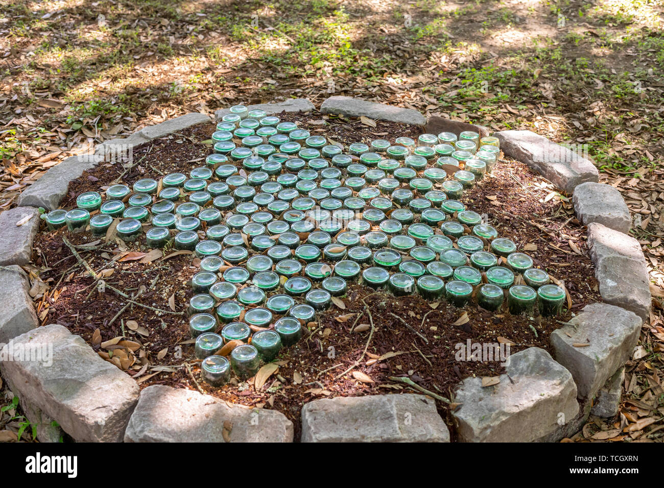 Carville, Louisiana - Old Coca-Cola bottles decorate the grounds of the National Hansen's Disease Museum. Once a facility where people with Hansen's D - Stock Image
