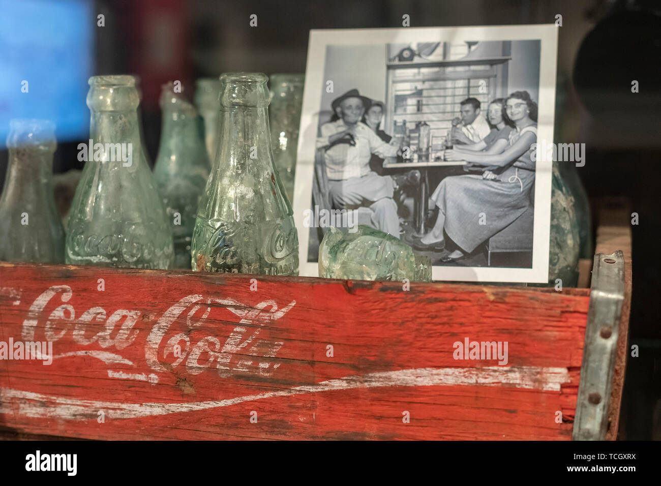 Carville, Louisiana - Old Coca-Cola bottles are displayed at the National Hansen's Disease Museum. Once a facility where people with Hansen's Disease  - Stock Image