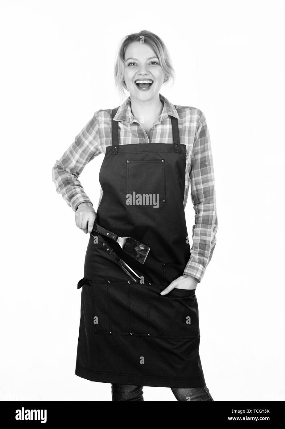 Positive housewife. food cooking recipe. Picnic barbecue. Pretty girl in chef apron. Tools for cook. Woman hold kitchen utensils. Preparation and culinary. Family weekend. - Stock Image