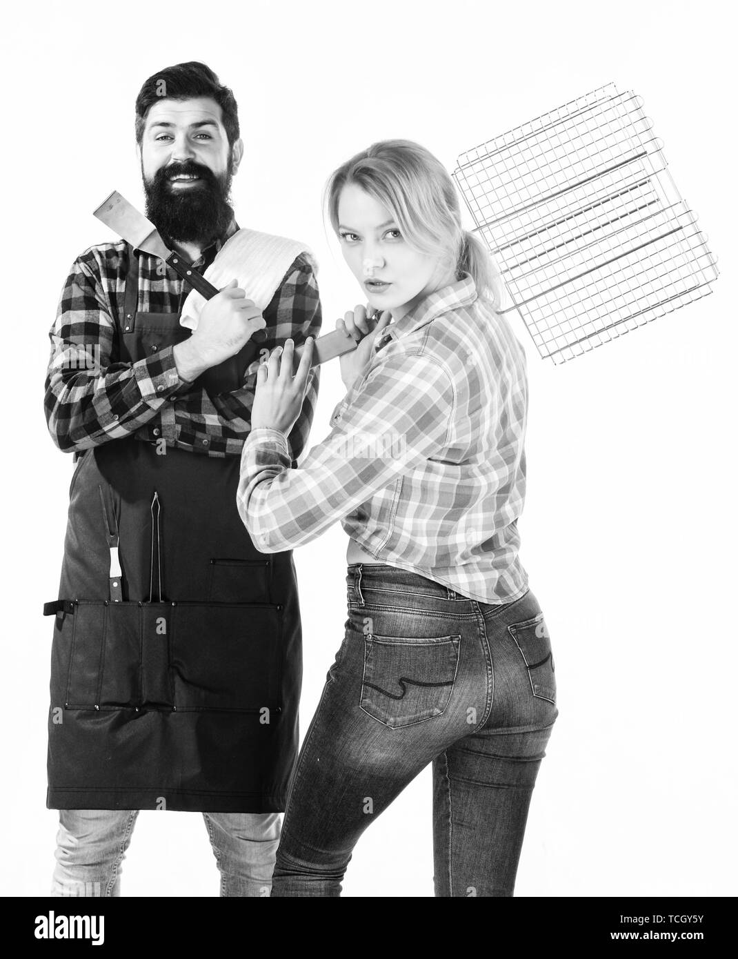 Enjoying happy moments. Family weekend. Picnic barbecue. food cooking recipe. Man bearded hipster and girl. Preparation and culinary. Couple in love hold kitchen utensils. Tools for roasting meat. - Stock Image