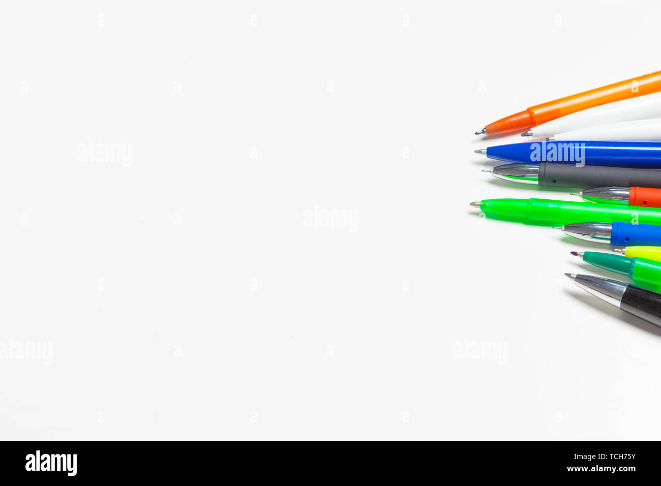 different colors pens isolated on the white background - Stock Image