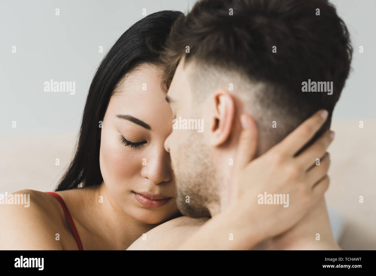 512cd76ec47 selective focus of beautiful, pensive asian woman embracing boyfriend with closed  eyes