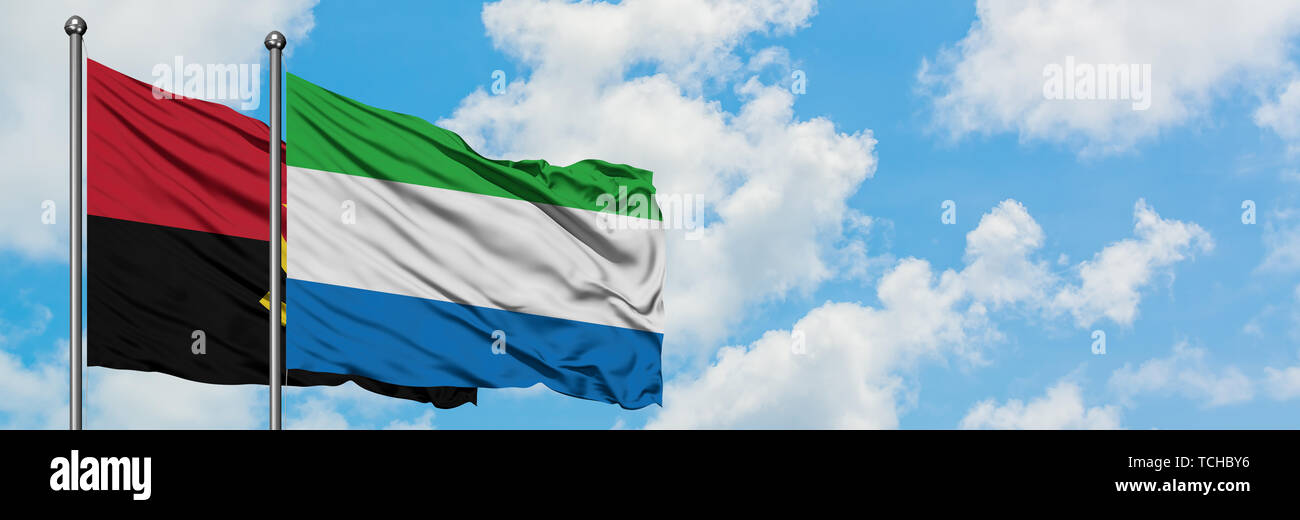 Angola and Sierra Leone flag waving in the wind against white cloudy blue sky together. Diplomacy concept, international relations. Stock Photo