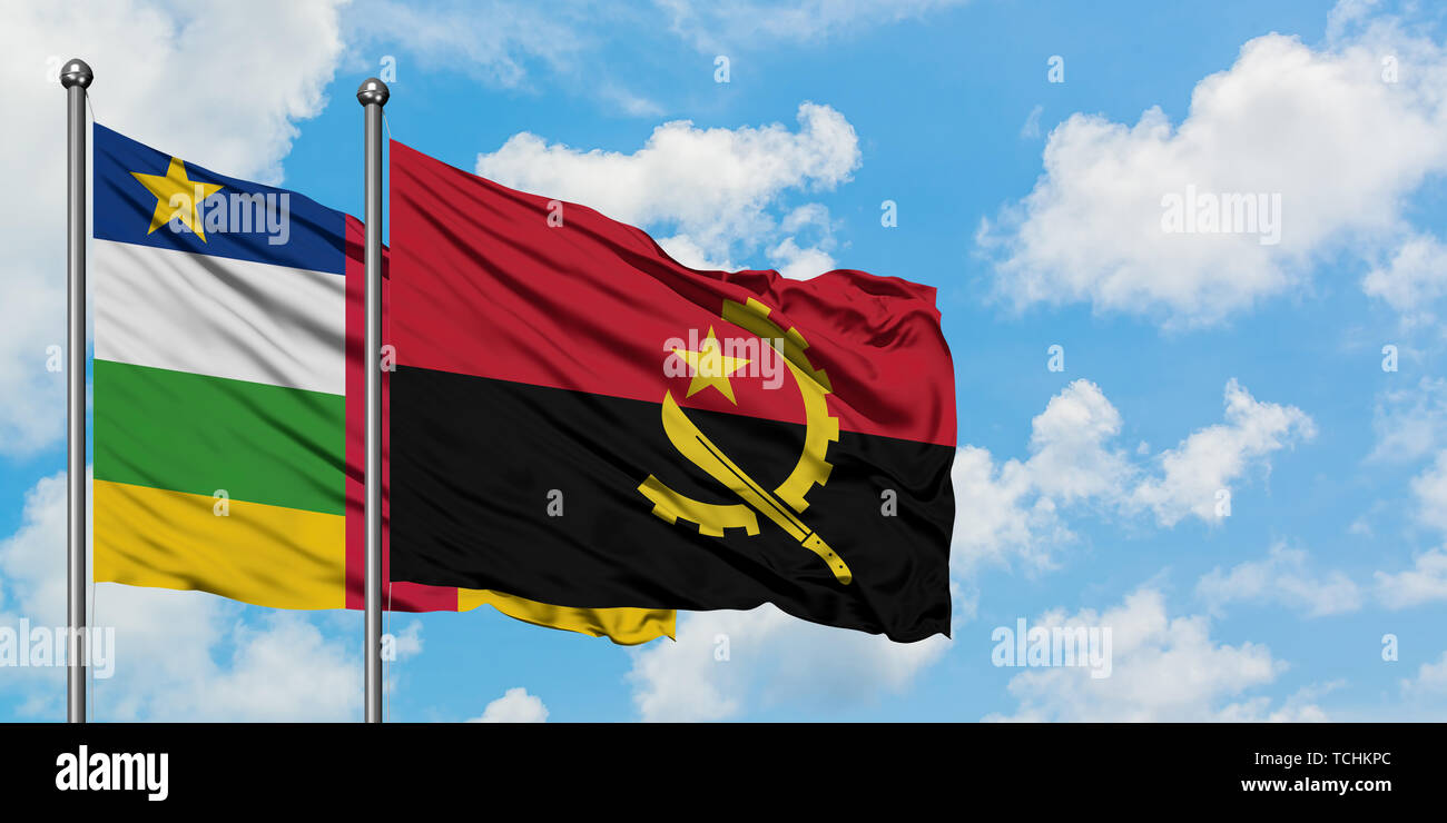 Central African Republic and Angola flag waving in the wind against white cloudy blue sky together. Diplomacy concept, international relations. - Stock Image