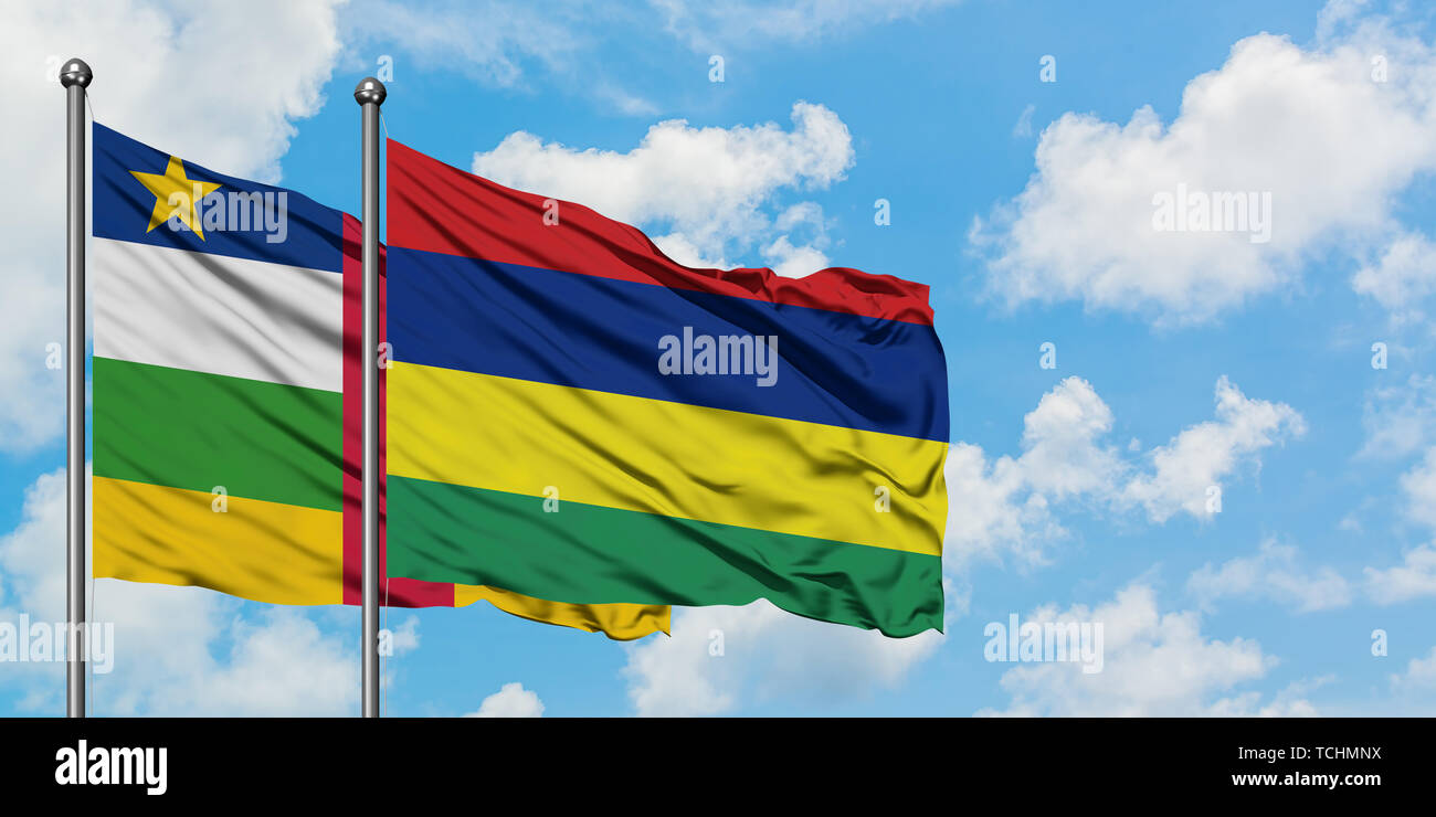 Central African Republic and Mauritius flag waving in the wind against white cloudy blue sky together. Diplomacy concept, international relations. - Stock Image