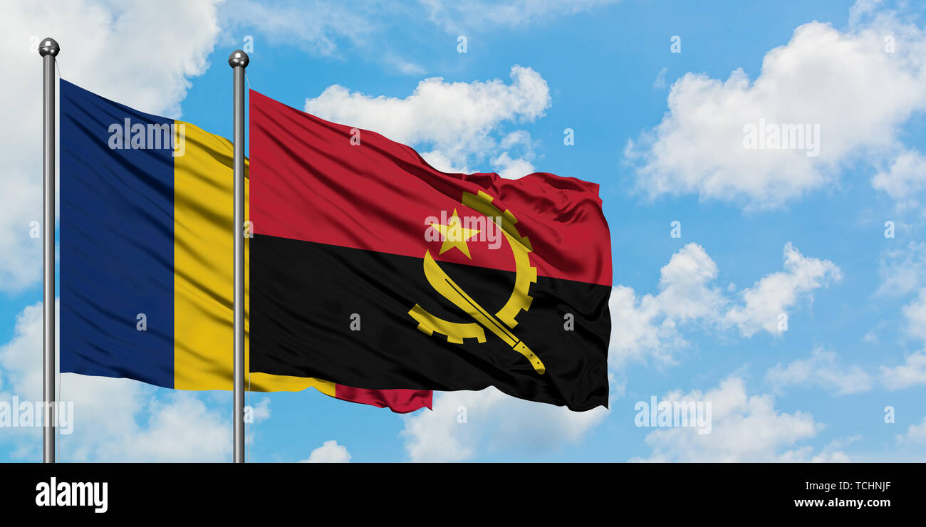 Chad and Angola flag waving in the wind against white cloudy blue sky together. Diplomacy concept, international relations. Stock Photo