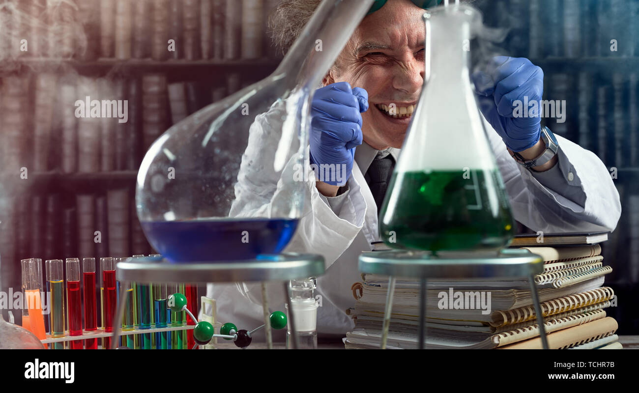 Happy chemist  with experiment succeeded, laughing in laboratory - Stock Image