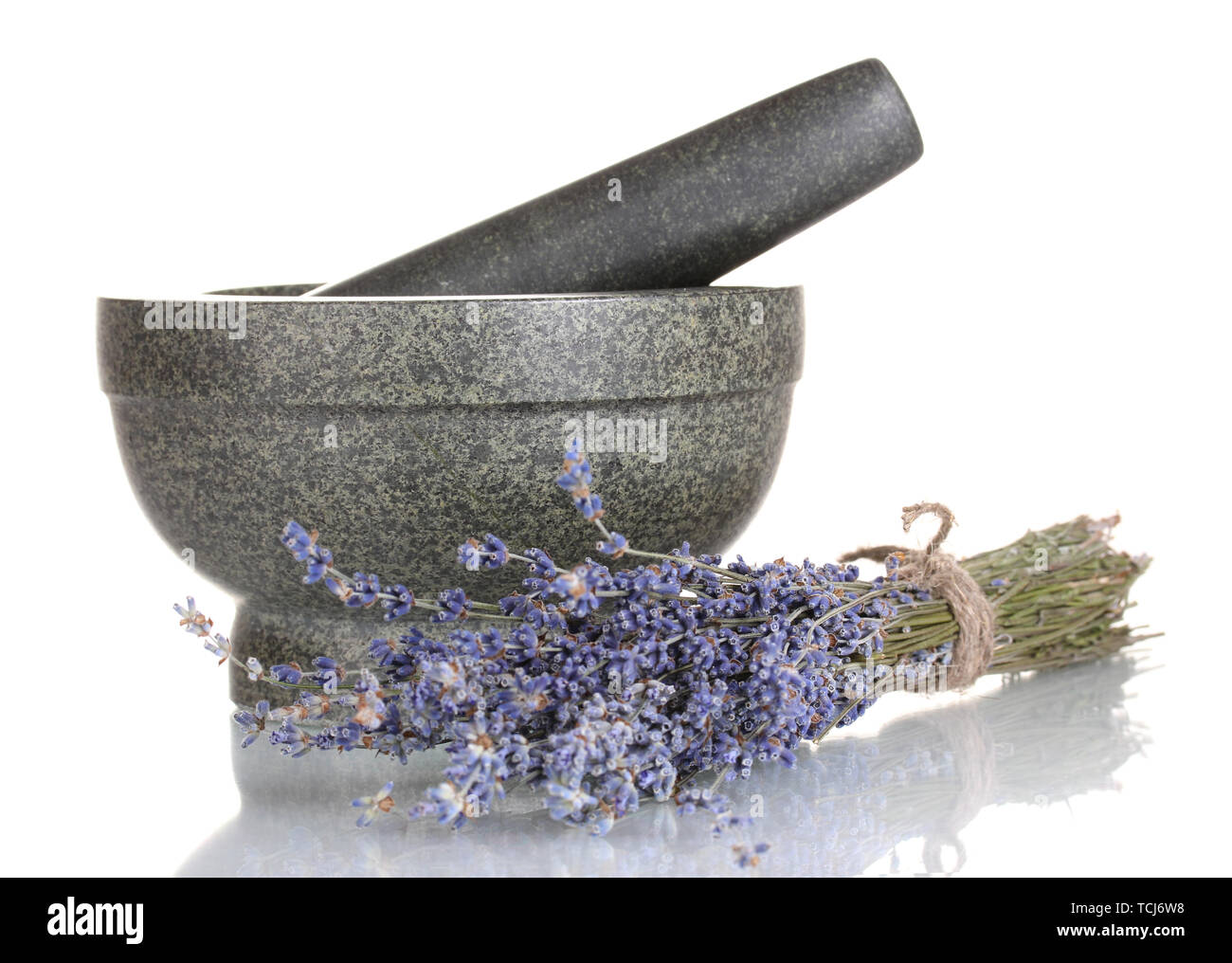 Lavender flowers with mortar and candles isolated on white Stock Photo