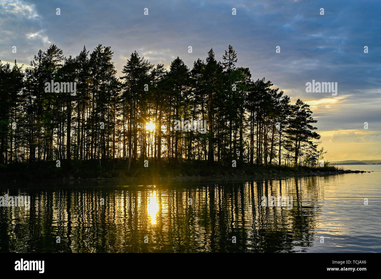 calm water and a nice sunset in Motala Sweden may 2019 - Stock Image