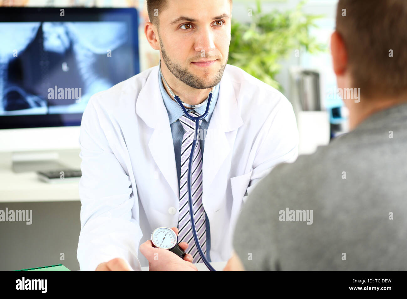 Young specialist in clinic cabinet - Stock Image