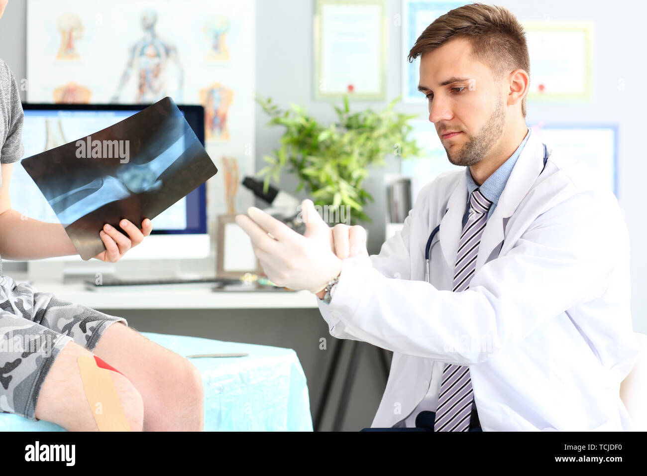 Smart doctor wearing gloves Stock Photo