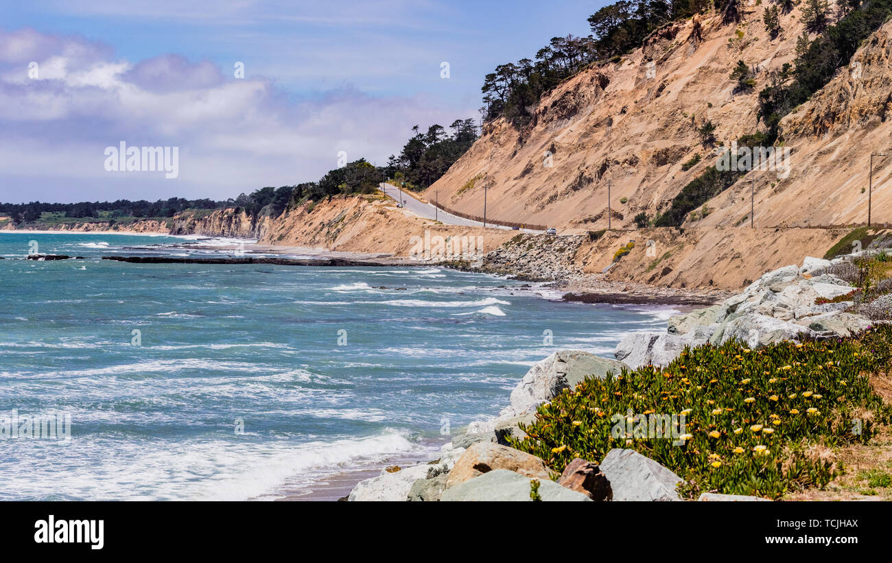The dramatic Pacific Ocean coastline close to Santa Cruz, California; the scenic Highway 1 and eroded cliffs visible on the right - Stock Image