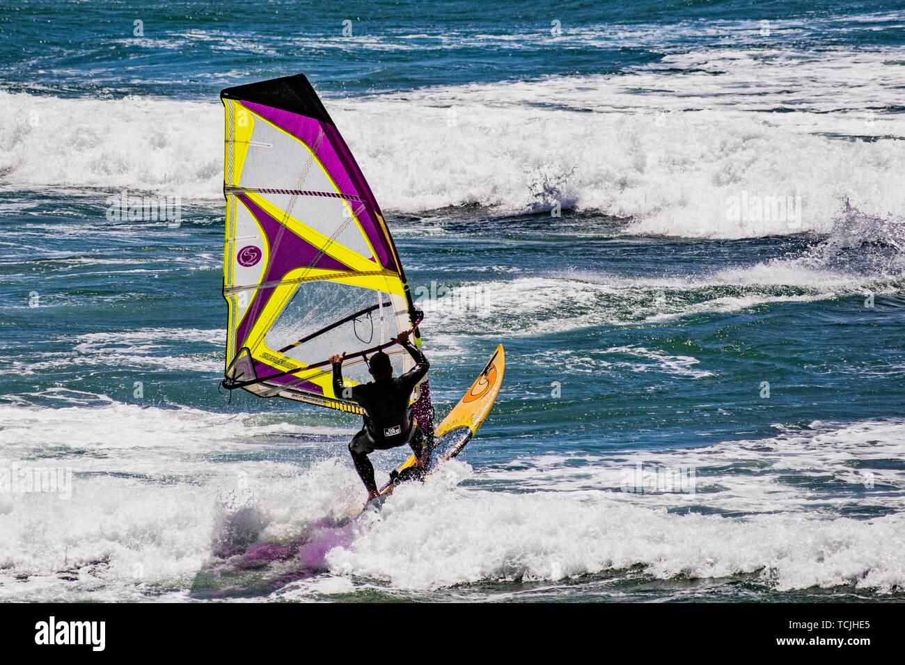 June 6, 2019 Davenport / CA / USA - Man windsurfing in the Pacific Ocean, near Santa Cruz, on a sunny and warm day - Stock Image
