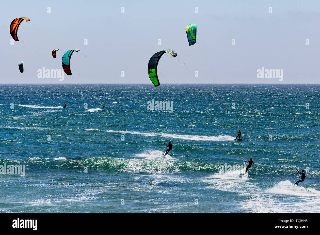 June 6, 2019 Davenport / CA / USA - People kite surfing in the Pacific Ocean, near Santa Cruz, on a sunny and warm day - Stock Image