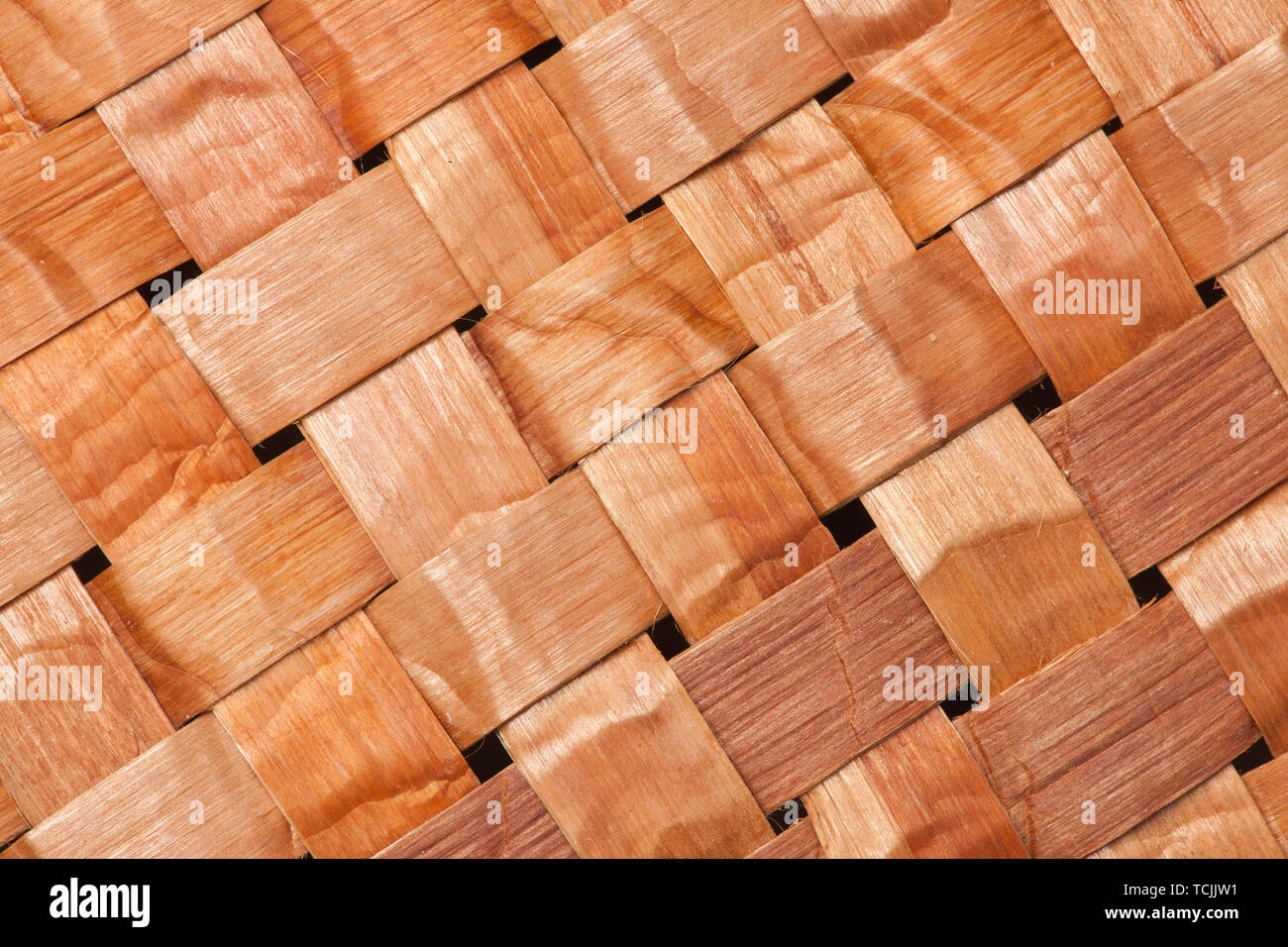 Close-up of a hand-woven mat made of pliant inner bark of a Western Red Cedar tree - Stock Image