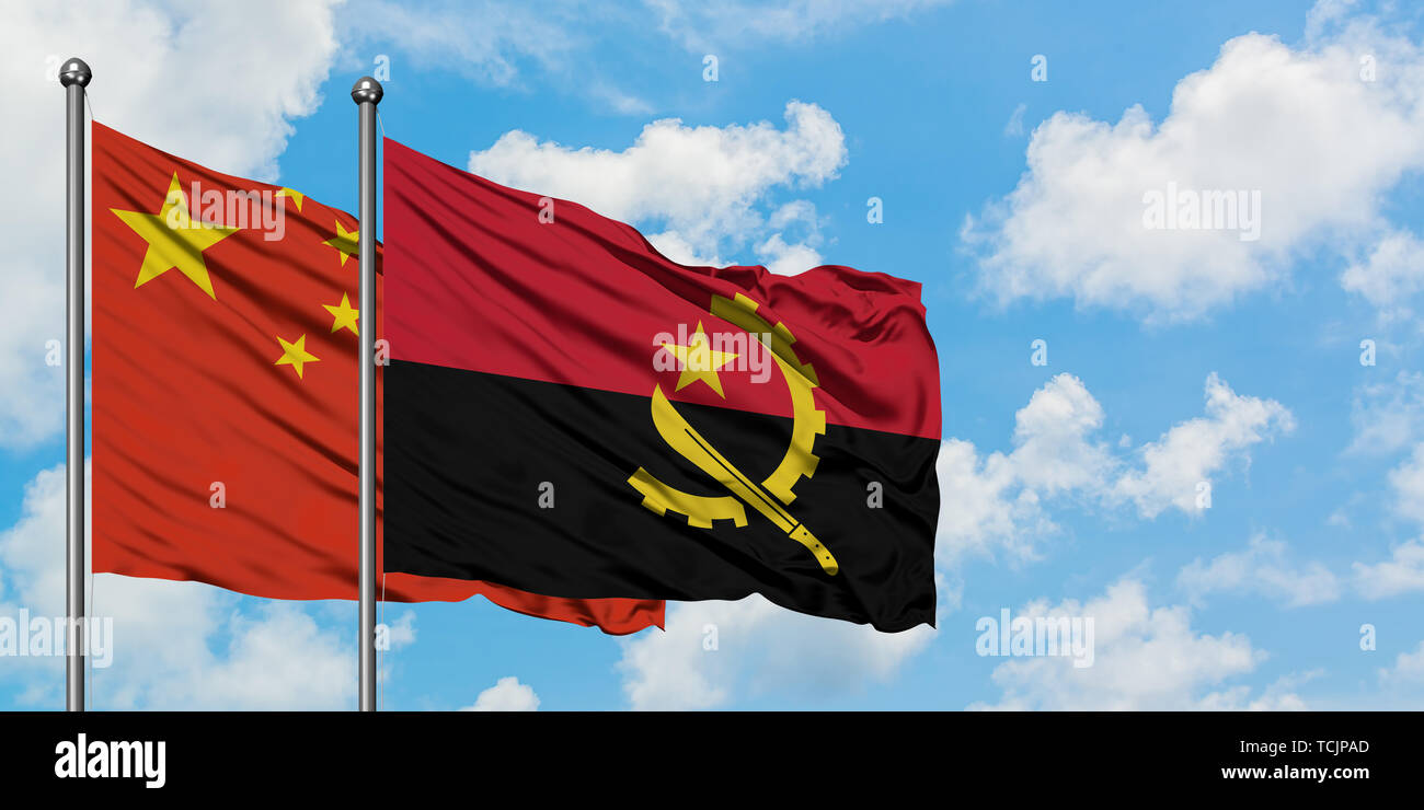 China and Angola flag waving in the wind against white cloudy blue sky together. Diplomacy concept, international relations. - Stock Image