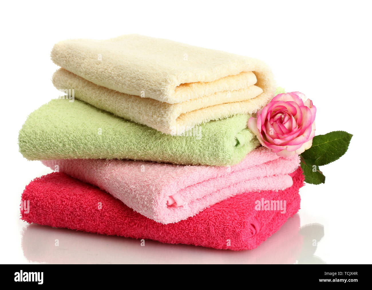 bright towels and rose isolated on white Stock Photo