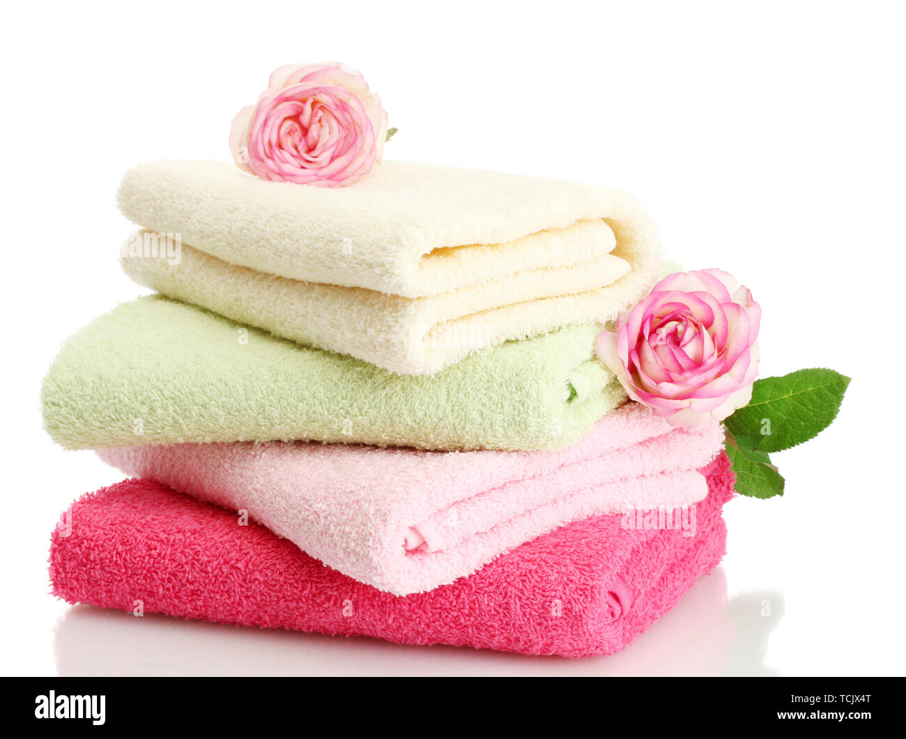 bright towels and roses isolated on white Stock Photo