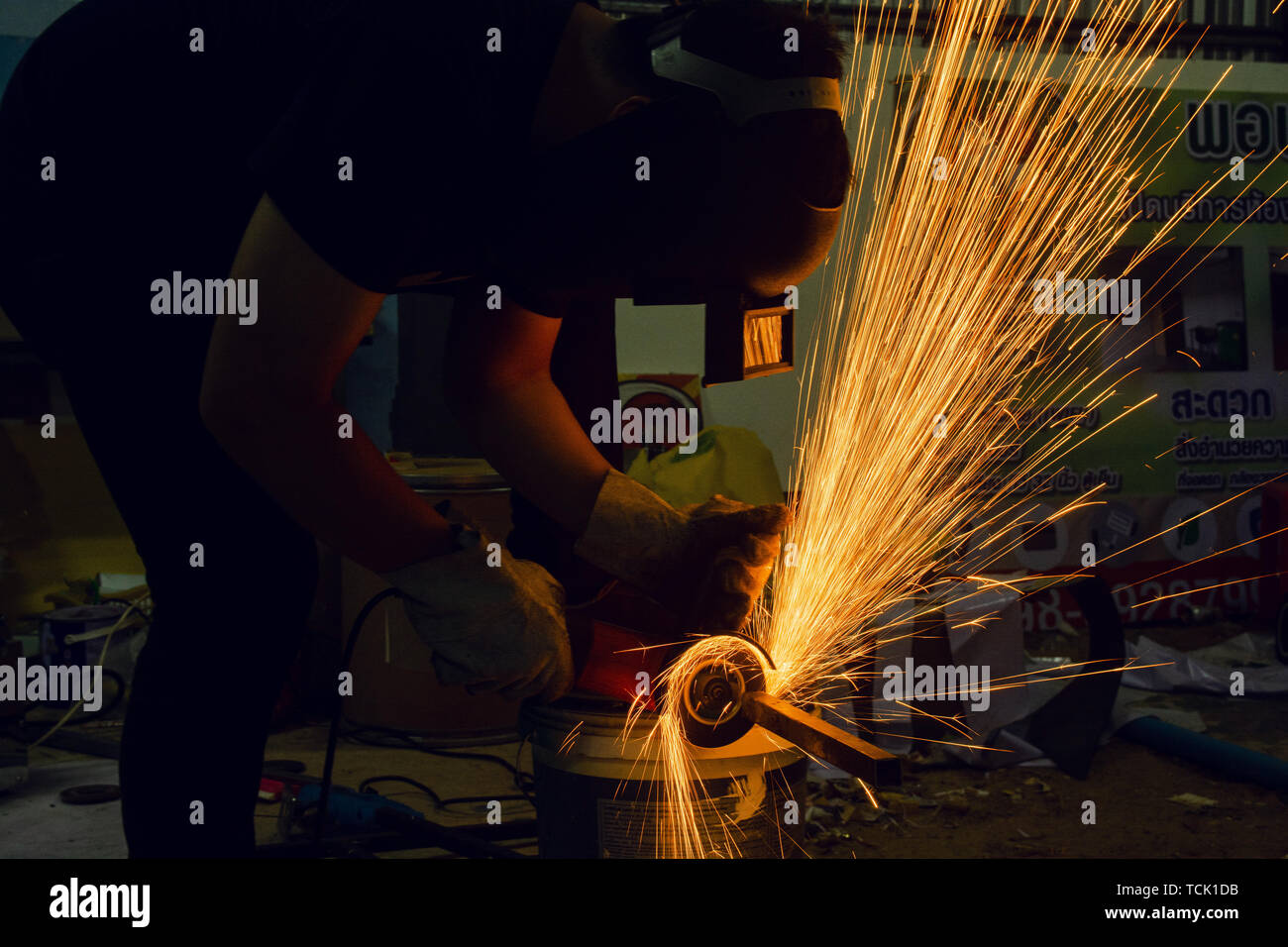 Electric wheel grinding cuting on steel. sparks from cutting - Stock Image