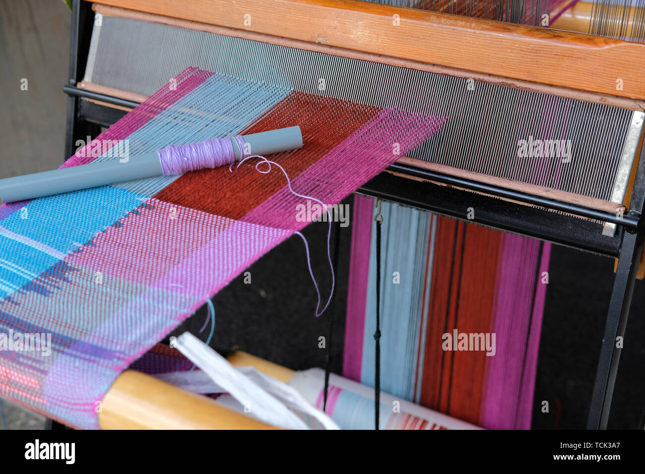 traditional weaving machine wooden loom for making textile - Stock Image