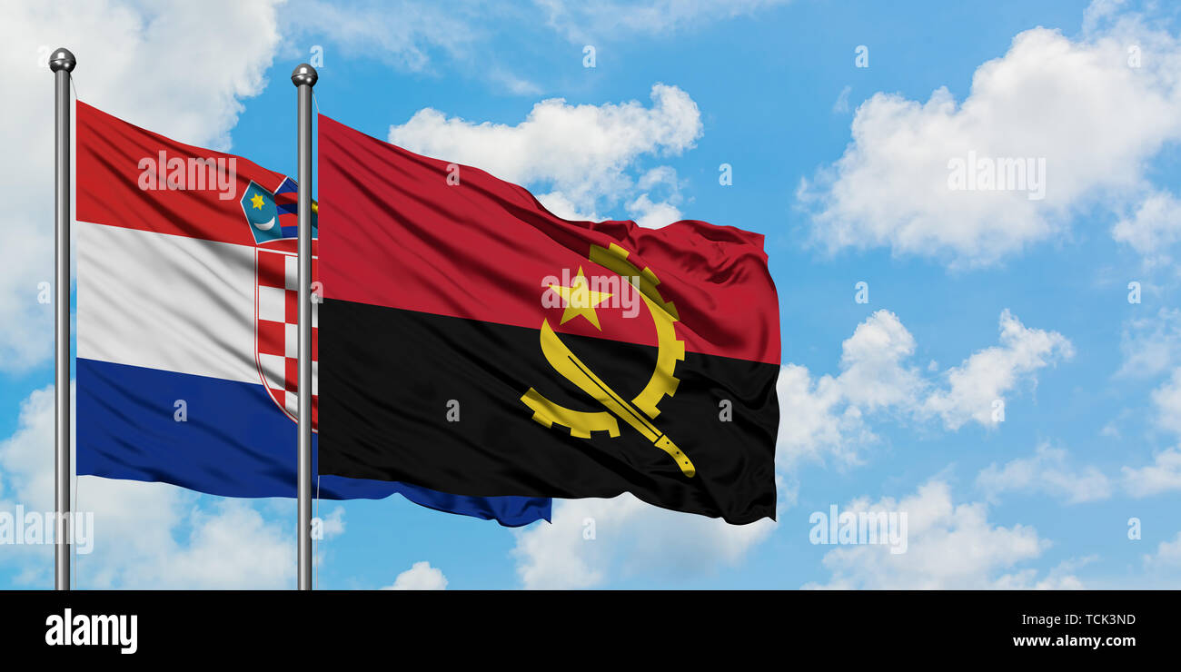 Croatia and Angola flag waving in the wind against white cloudy blue sky together. Diplomacy concept, international relations. - Stock Image
