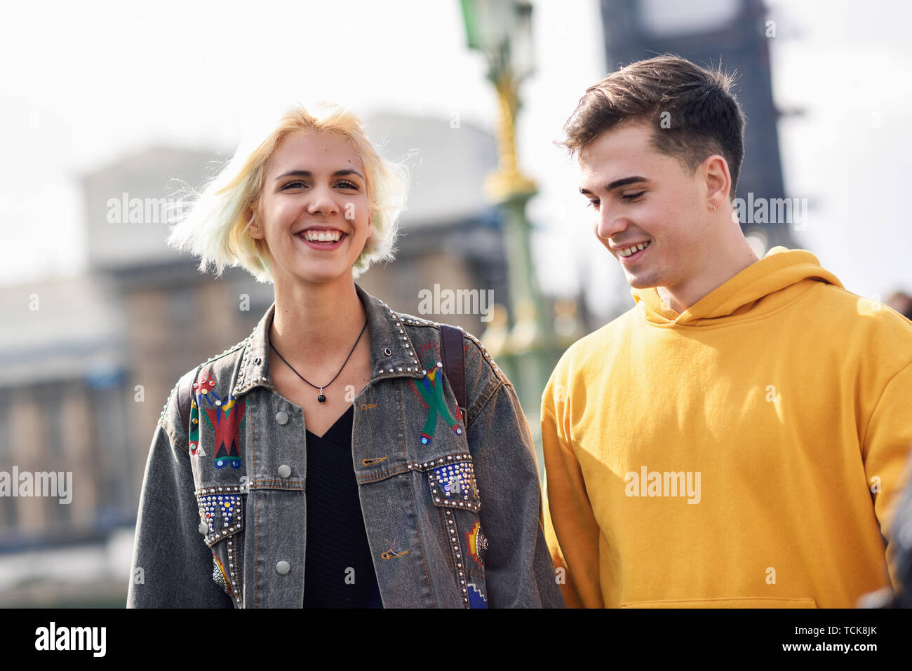 Happy couple by westminster bridge, River Thames, London. UK. - Stock Image