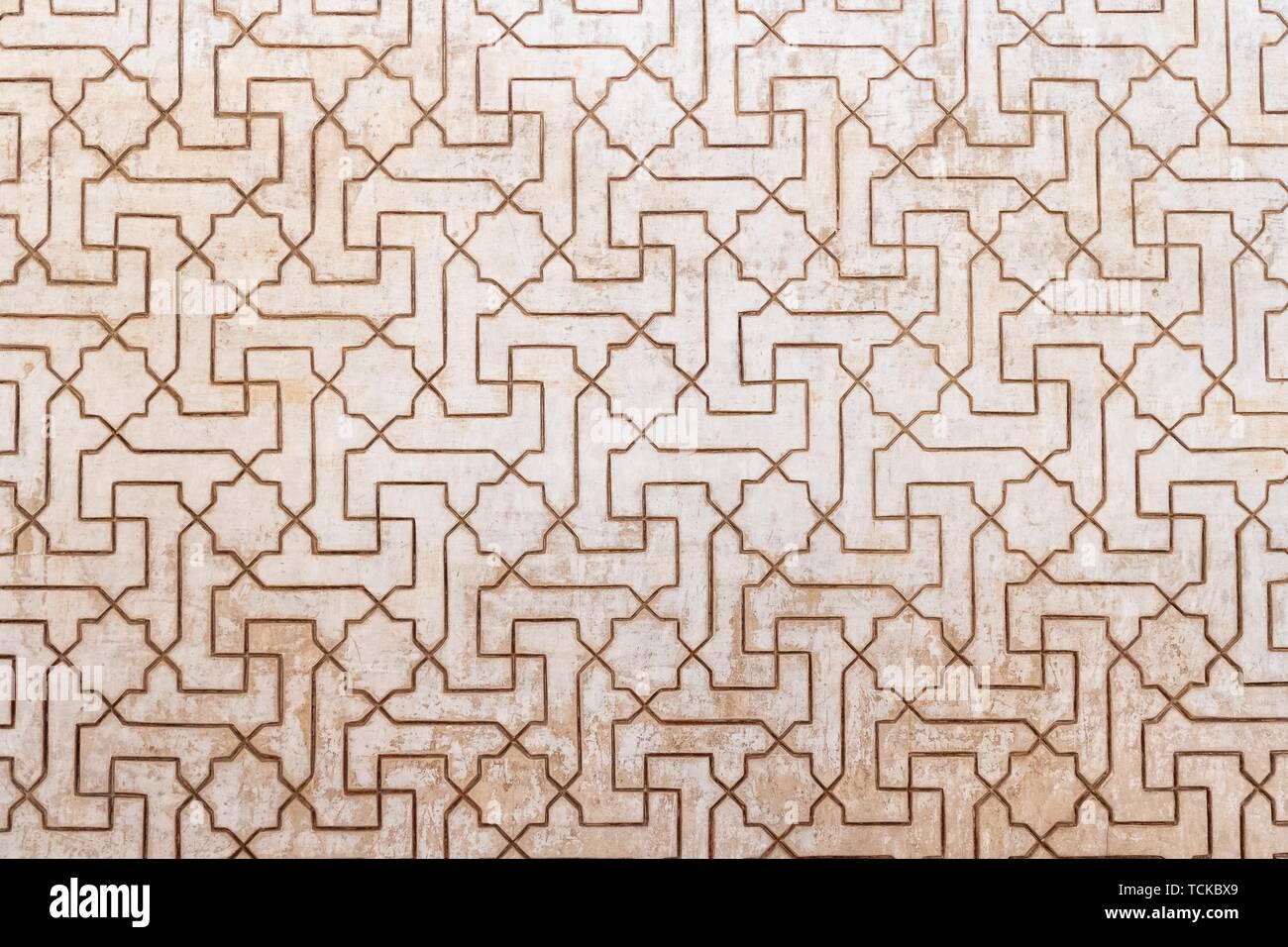 Geometric Moorish plaster decorations, Nazarite palaces, Alhambra, Granada, Andalusia, Spain - Stock Image