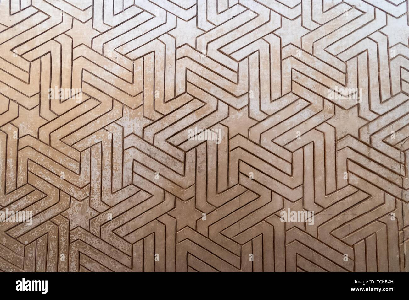 Geometric Moorish plaster decorations, Nazarite palaces, Alhambra, Granada, Andalusia, Spain Stock Photo