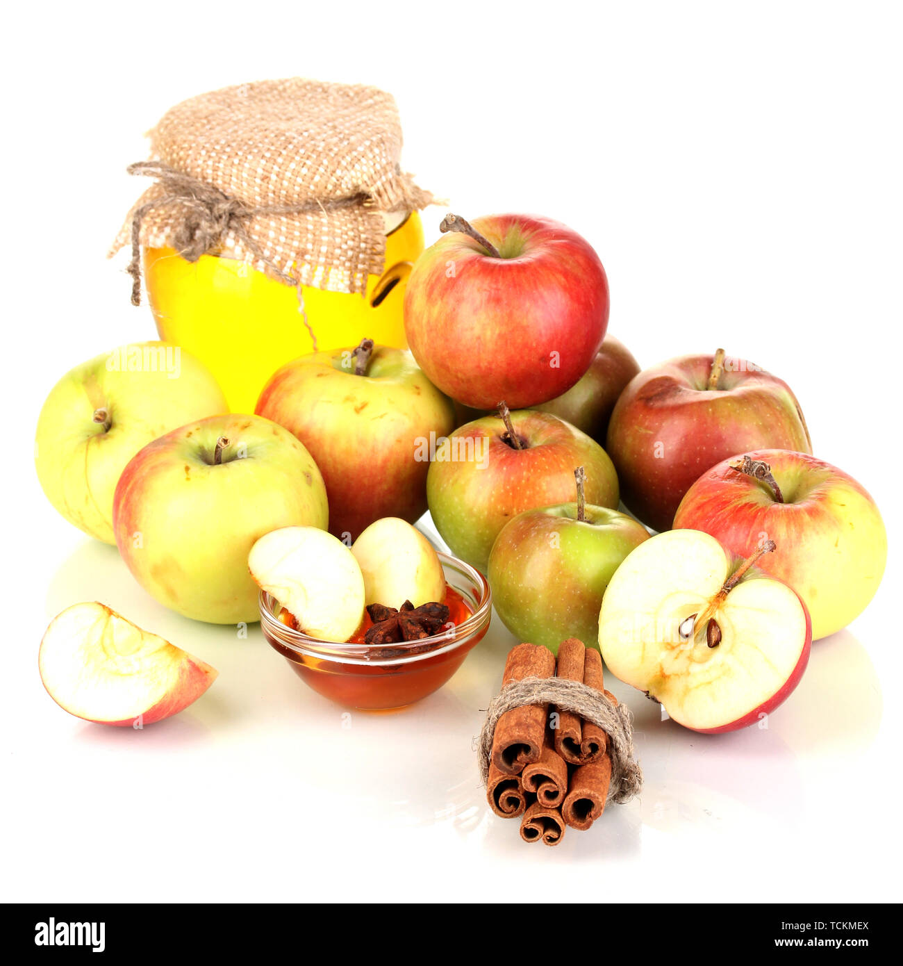 Honey and apples with cinnamon isolated on white - Stock Image