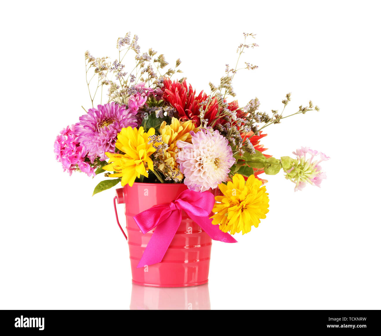 Bright pink bucket with flowers isolated on white - Stock Image