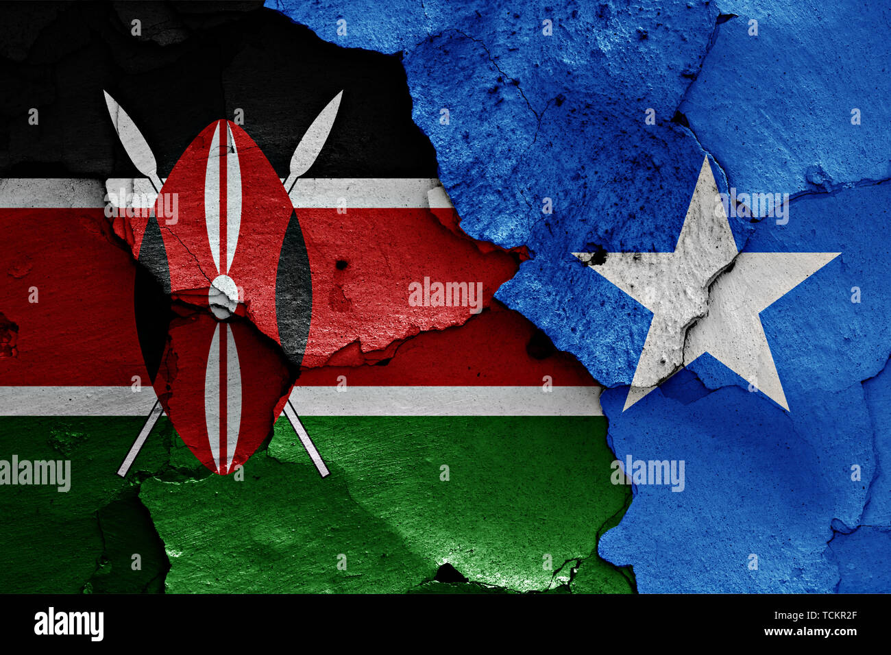 flags of Kenya and Somalia painted on cracked wall - Stock Image