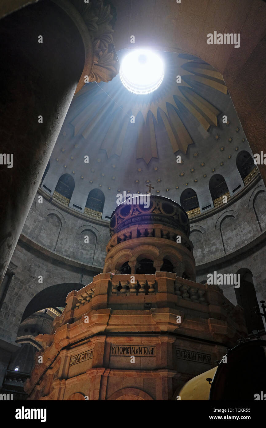 Ray of sunlight breaks through the ceiling over the Edicule, the shrine that tradition says houses the cave where Jesus was entombed and resurrected, at the Church of the Holy Sepulchre in the Christian Quarter old city East Jerusalem Israel Stock Photo