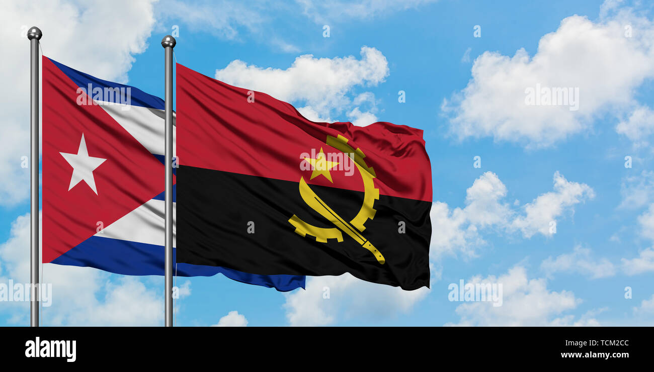 Cuba and Angola flag waving in the wind against white cloudy blue sky together. Diplomacy concept, international relations. - Stock Image
