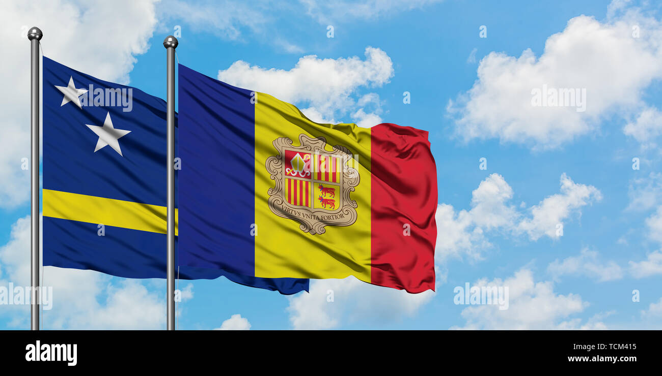 Curacao and Andorra flag waving in the wind against white cloudy blue sky together. Diplomacy concept, international relations. Stock Photo