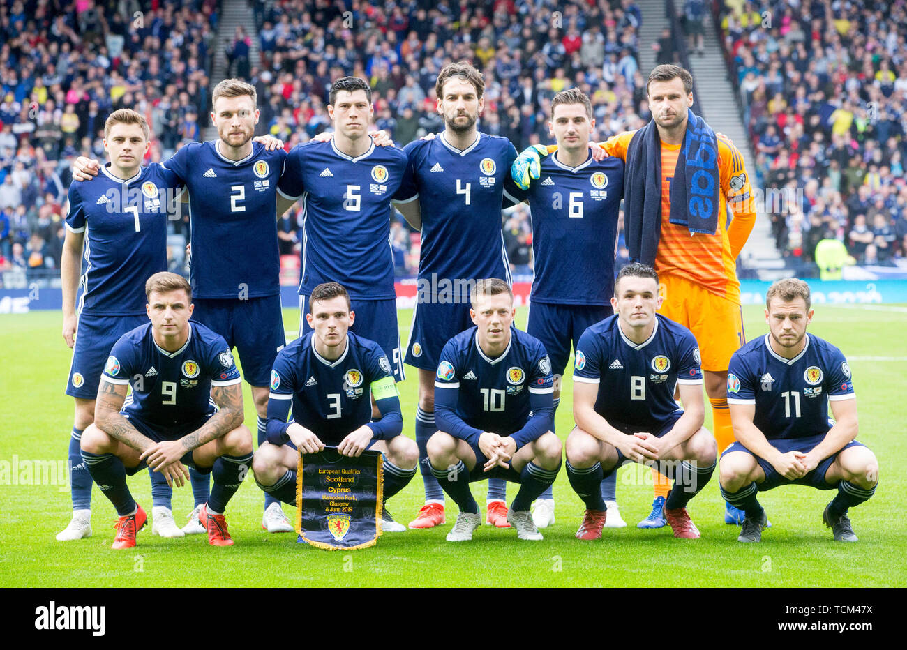 Scotland's James Forrest (back left to right), Stephen O'Donnell, Scott McKenna, Charlie Mulgrew, Kenny McLean, David Marshall, Eamonn Brophy (front left to right), Andrew Robertson, Callum McGregor, John McGinn and Ryan Fraser pose for a photograph before the UEFA Euro 2020 Qualifying, Group I match at Hampden Park, Glasgow. - Stock Image