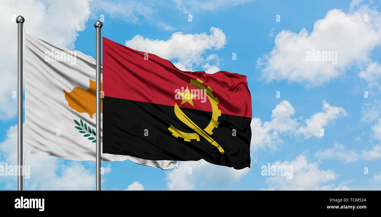 Cyprus and Angola flag waving in the wind against white cloudy blue sky together. Diplomacy concept, international relations. Stock Photo