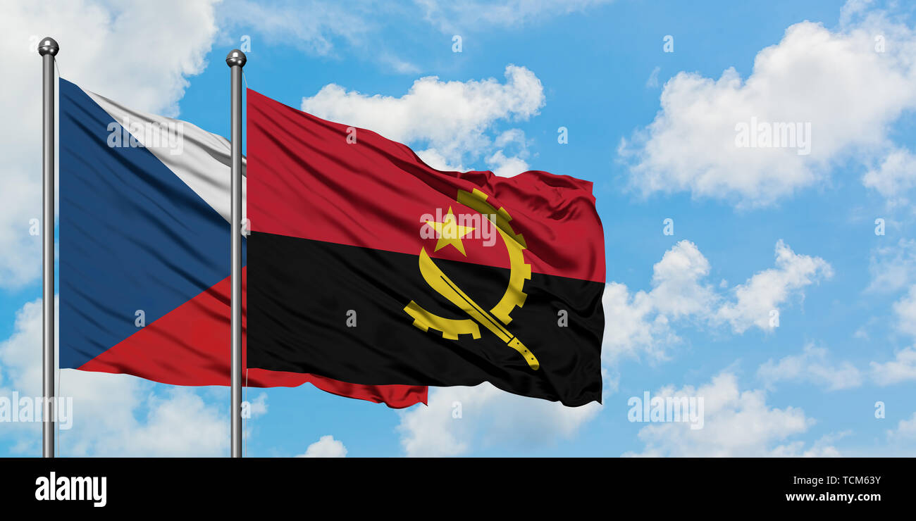 Czech Republic and Angola flag waving in the wind against white cloudy blue sky together. Diplomacy concept, international relations. - Stock Image