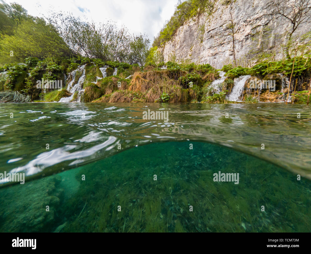 Amazing Split View Of Waterfalls Falling Into Lake Plitvice