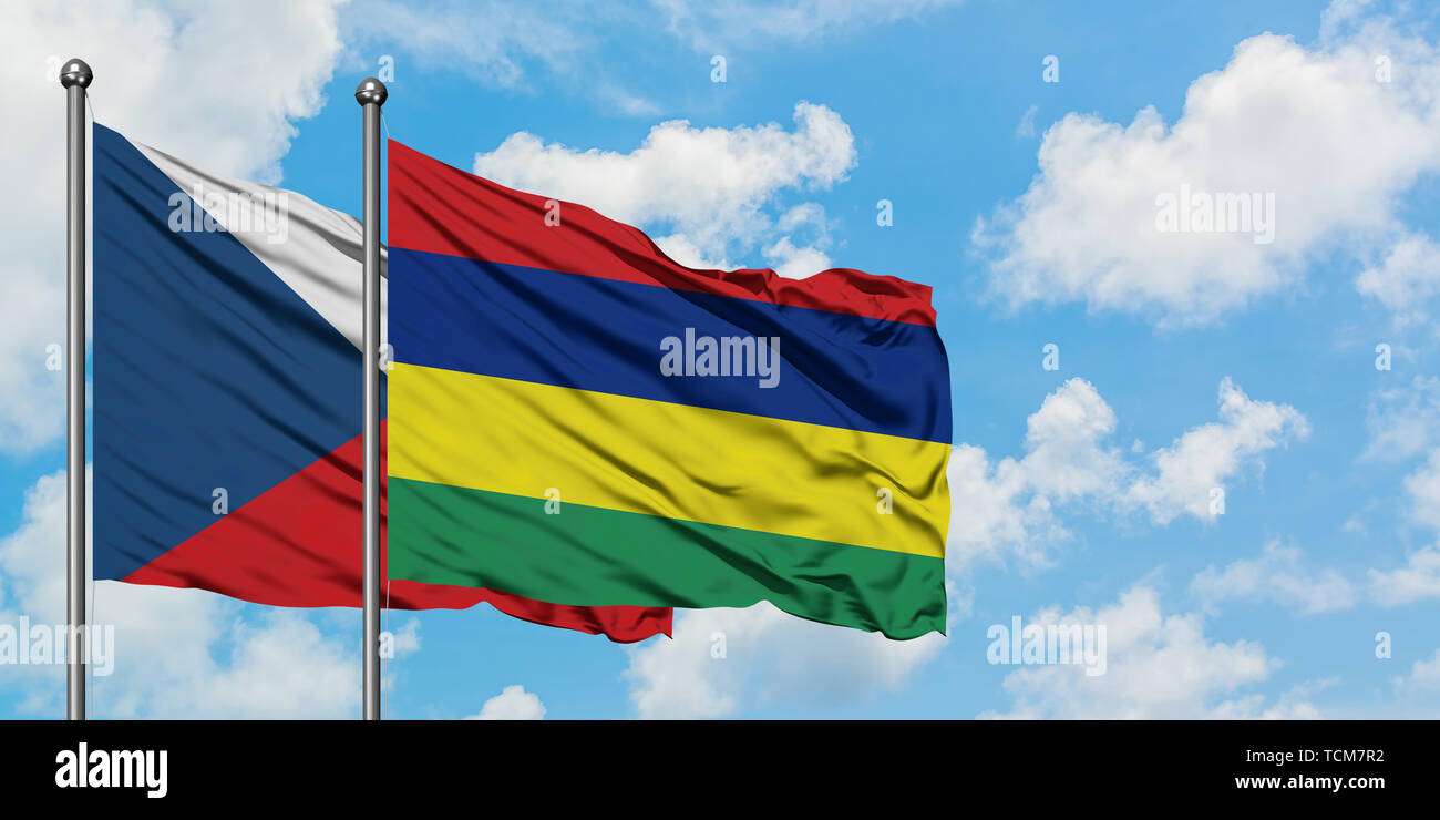 Czech Republic and Mauritius flag waving in the wind against white cloudy blue sky together. Diplomacy concept, international relations. Stock Photo