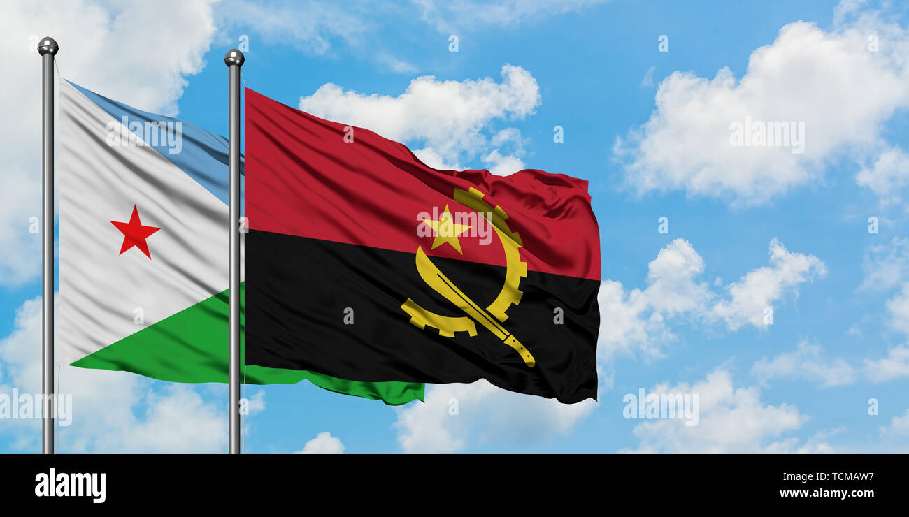 Djibouti and Angola flag waving in the wind against white cloudy blue sky together. Diplomacy concept, international relations. Stock Photo
