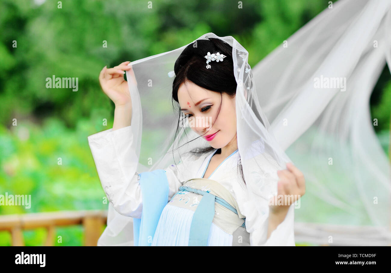 A beautiful Asian woman in the open air,portraits Stock Photo