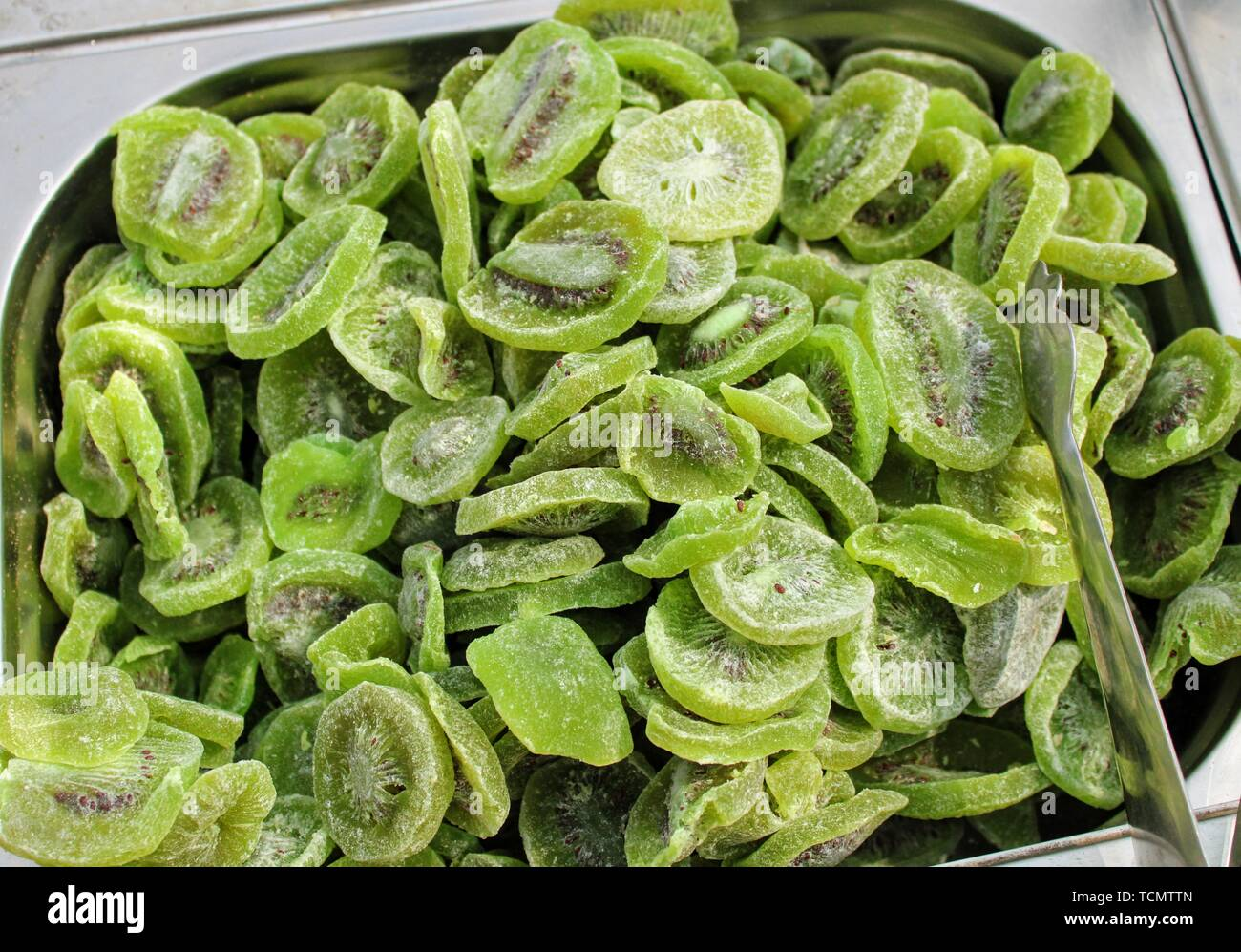 Rich and healthy slices of dried kiwi in the market Stock Photo