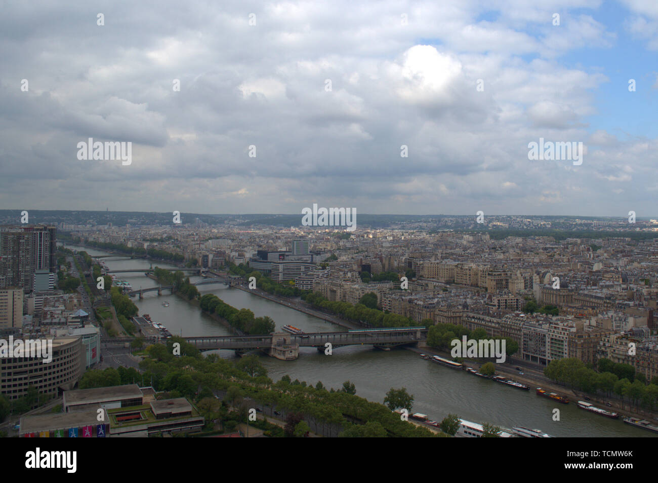 View of the city of Paris, the Seine river and the Island of the Swans, from the second platform of the Eiffel Tower, heading west. Stock Photo