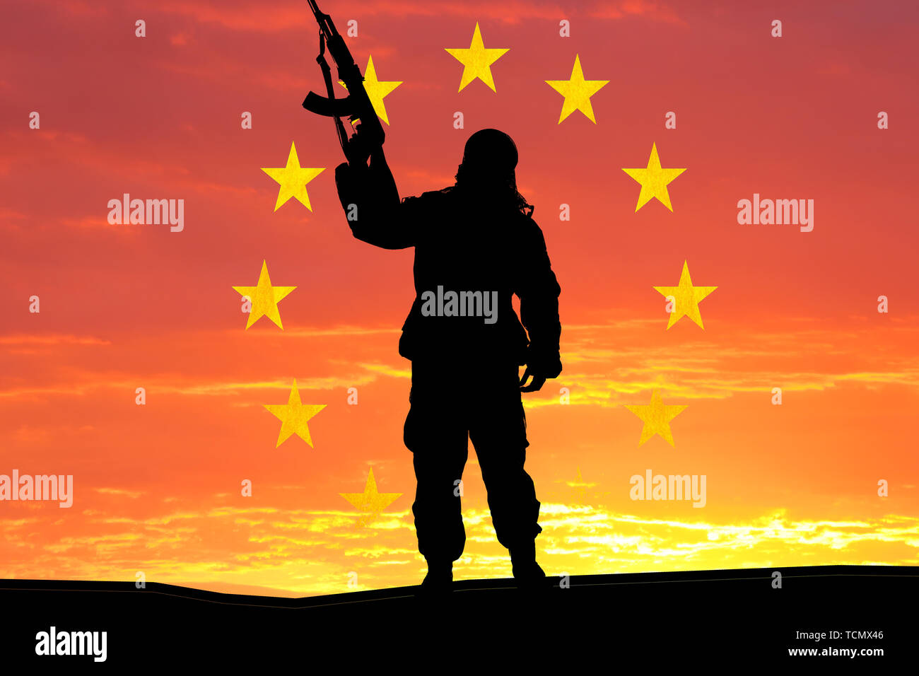 Silhouette of military soldier, shot, holding gun, colorful sky, Concept of a terrorist. Silhouette terrorists with rifle, national flag on background Stock Photo
