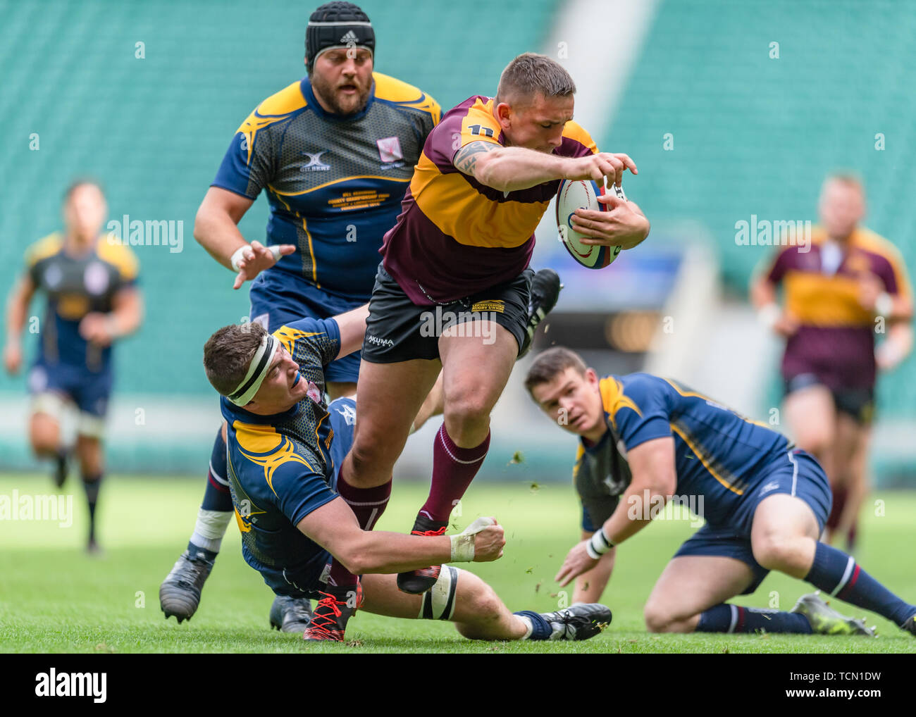 London, UK. 08th, Jun 2019. Leicestershire's Callum Dacey (centre) is tackled during Bill Beaumont County Championship Division 2 Final: Surrey v Leicestershire at Twickenham Stadium on Saturday, 08 June 2019. LONDON England .  (Editorial use only, license required for commercial use. No use in betting, games or a single club/league/player publications.) Credit: Taka G Wu/Alamy Live News Stock Photo